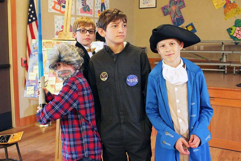 Fifth-graders strike a pose in living wax museum
