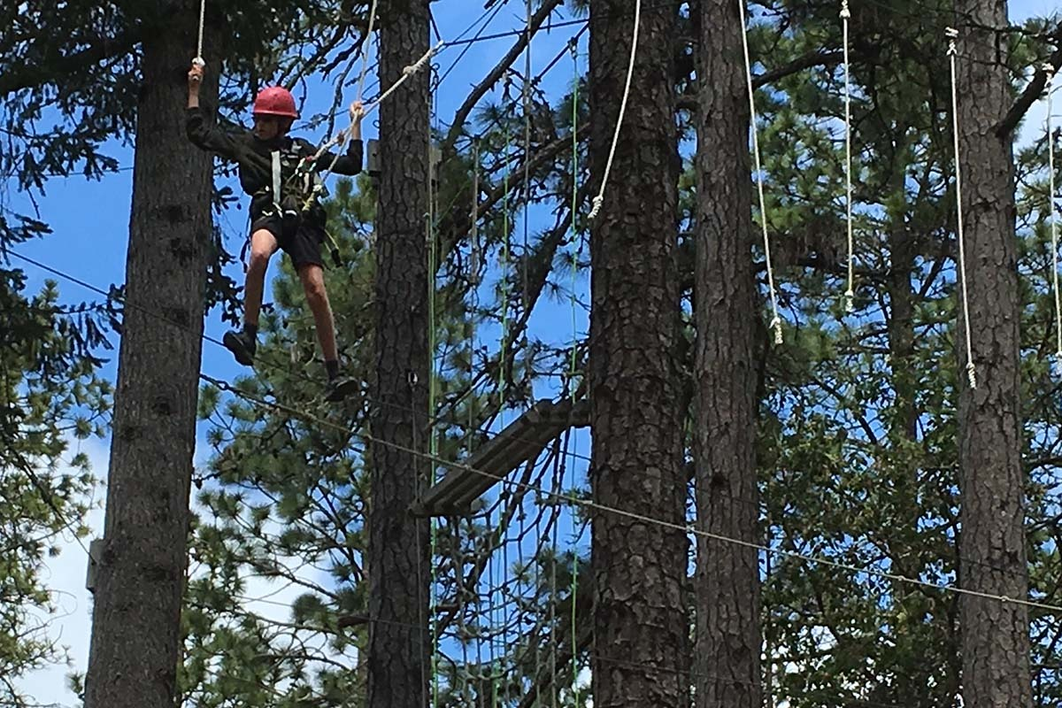 Sixth-graders do some treetop team-building at Mount Hermon