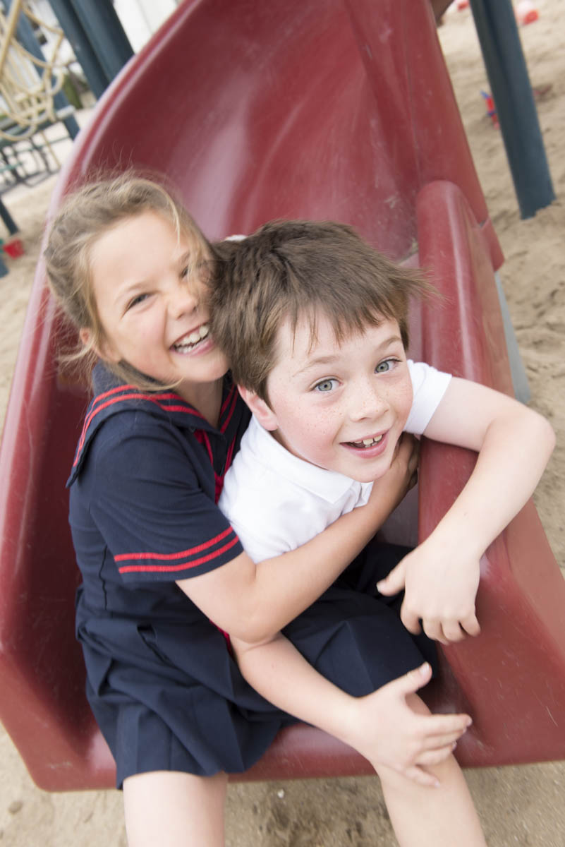 Girl and boy on slide