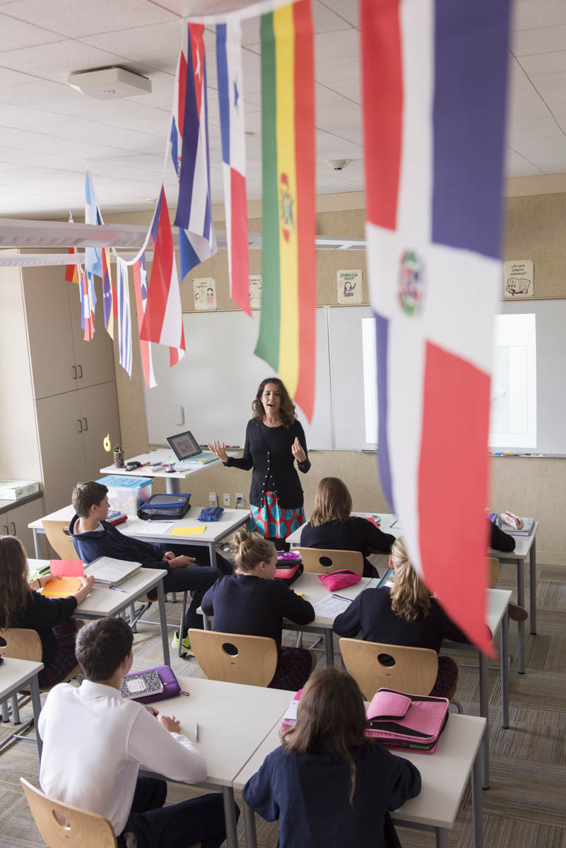 International flags hang in class