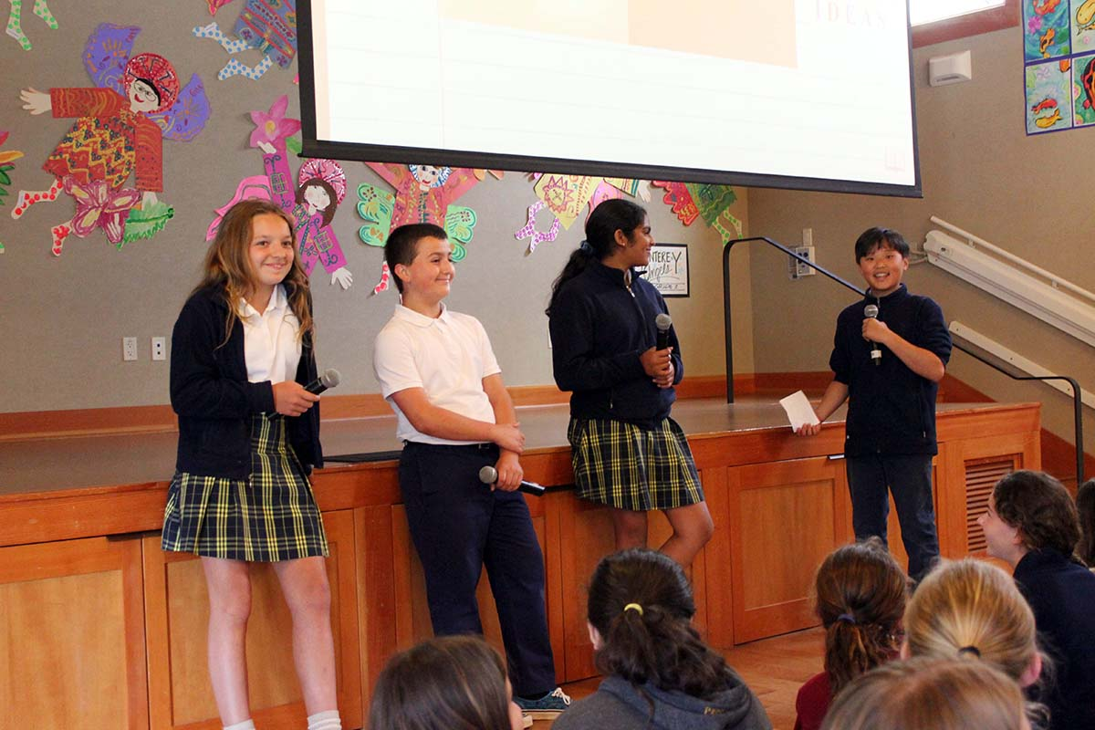 Four students lead assembly