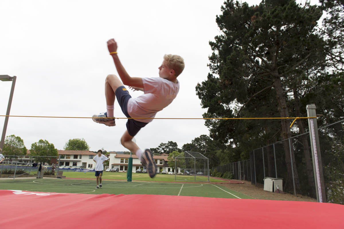 Boy doing high jump
