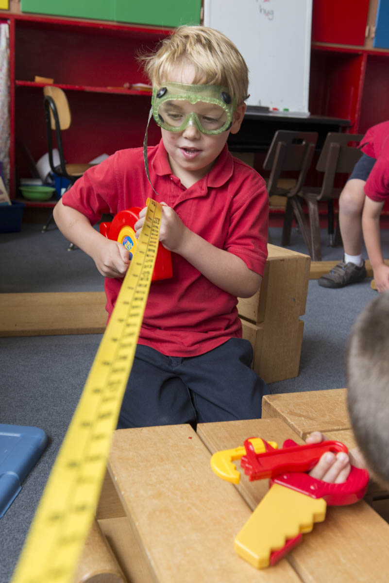 Boy in goggles with measuring tape